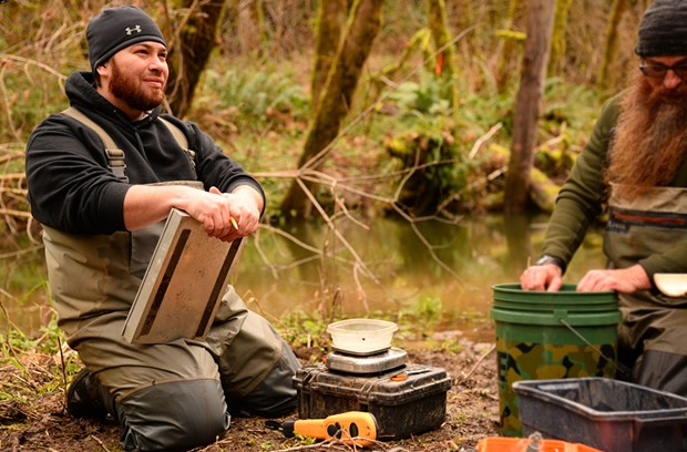 Yurok fisheries technician Nick Folkins records data on Coho salmon in a recently restored stretch of McGarvey Creek. The Yurok Tribe implements large-scale river restoration projects throughout the Klamath River Basin. - COURTESY OF THE YUROK TRIBE