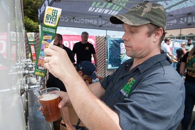Local beer was on tap at the Oyster Fest alternative Shuck Yeah. - PHOTO BY MARK MCKENNA