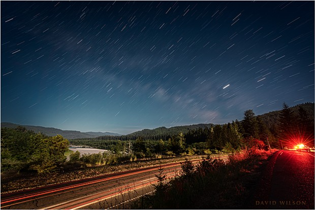 The paths the stars make as the Earth turns beneath them are revealed in this long exposure overlooking the Eel River Valley from Vista Point, Humboldt County, California. - DAVID WILSON