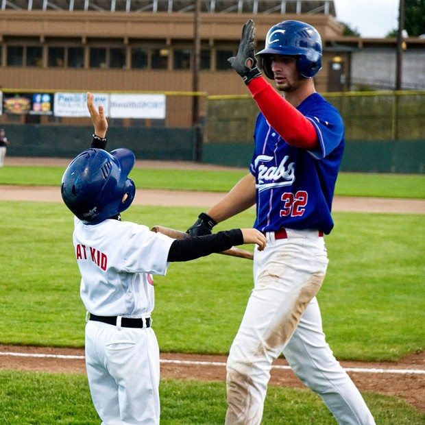 New Crab Vinny Bologna celebrates with the Bat Kid after scoring a run in Tuesday's game - MATT FILAR