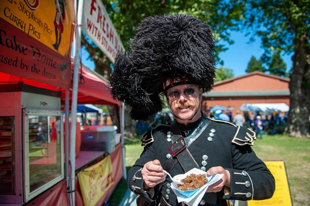 Andrew Endsley enjoys some haggis at the Highland Games on Sunday. - PHOTO BY MARK MCKENNA