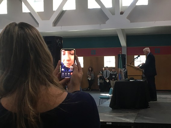 Eureka City Councilmember Natalie Arroyo watches via FaceTime as City Manager Greg Sparks reads her letter commemorating the return of Duluwat Island. - THADEUS GREENSON