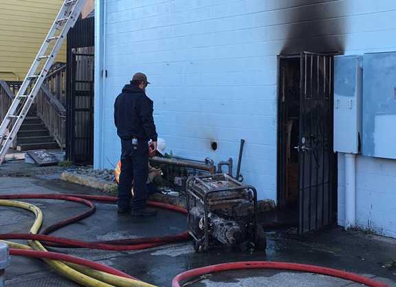 A generator reportedly caught fire behind Big Blue Cafe in Arcata on Oct. 27. - PHOTOS BY RYAN HUTSON