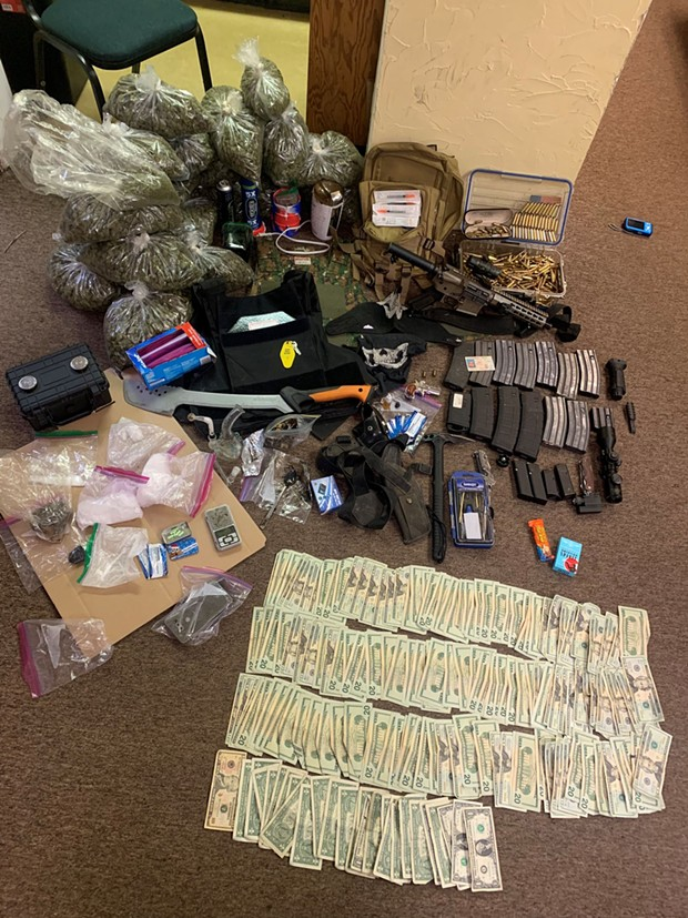 Drug, guns and money found in the vehicle. - HCSO