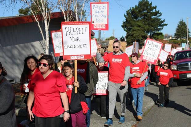 Healthcare workers marching toward Walgreens on Harris Street. - IRIDIAN CASAREZ