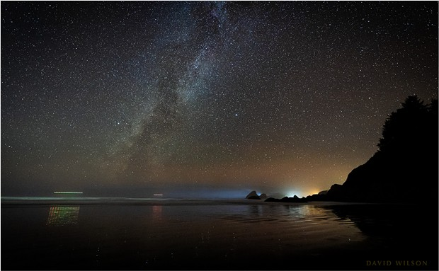 Reflections at Moonstone Beach. While we waited for meteors, a pair of helicopters skimmed the horizon as blinking dots sliding toward Trinidad's glow. The rest of the galaxy hanging overhead didn't notice us. Humboldt County, California., November 21, 2019. - DAVID WILSON