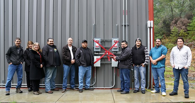 Yurok Chairman Joseph L. James, accompanied by Yurok Tribal Council, Yurok Planning & Community Development Department and Schatz Energy Research Center celebrate the installation of a 28 Kw photovoltaic (solar panel system).