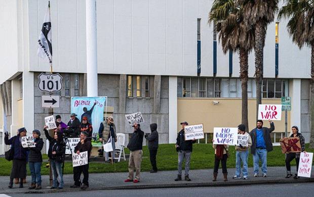 Protesters outside the courthouse elicit honks and shouts from passing cars. - PHOTO BY ZACH LATHOURIS