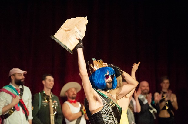 Newly crowned Mr. Humboldt winner Mister Cister holds the Big Wood award aloft. - PHOTO BY MARK MCKENNA