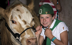 Proud 4-H kid Jocie Hague with her prize cow at the Humboldt County Fair. The Redwood Acres Fair, which also features 4-H and FFA animals, is canceled for 2020. - PHOTO BY MARK LARSON