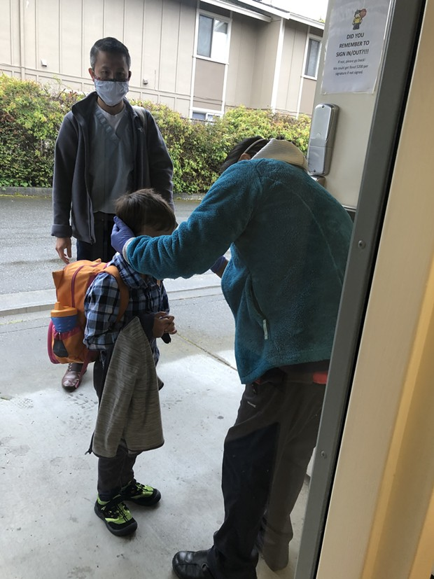 Dr. Kelvin Vu watches as his 5-year-old son Iver is checked in at Little Learners on a recent morning. - COURTESY OF LITTLE LEARNERS