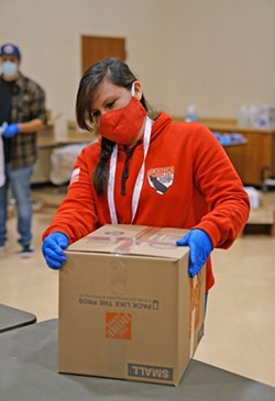 Yurok staff member Cassandra Charles packs a food box for Tribal elders. - SUBMITTED