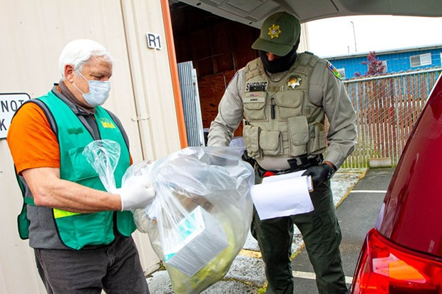 From left, CERT volunteer Cliff Van Cott and Humboldt County Sheriff's Office Correctional Officer Naveed Ahmed load a distribution van. - COUNTY OF HUMBOLDT