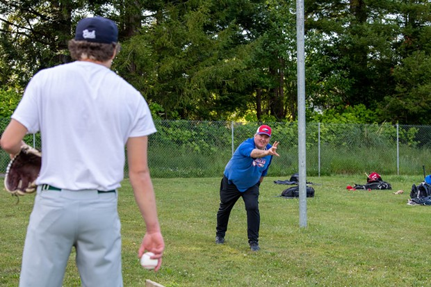Humboldt Eagles board member Jim Pastori instructs pitcher Hayden Bode to release the ball lower. - MARK MCKENNA