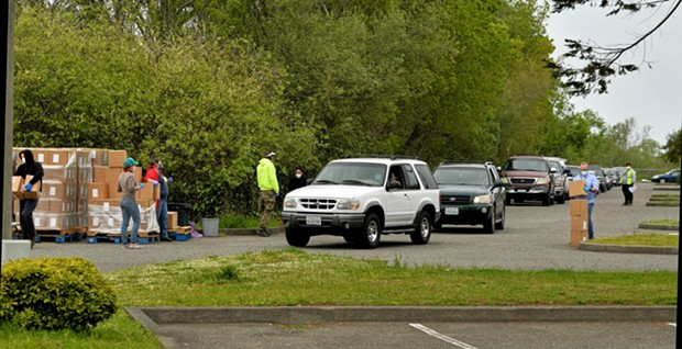 Cars line up for Food for People's food box distribution April 10. - PHIL GUTIERREZ