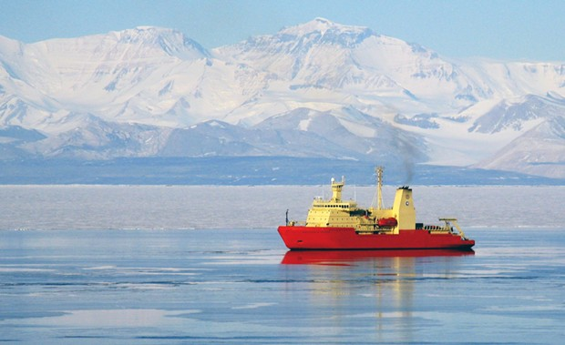 The research ship Nathaniel B. Palmer in McMurdo Sound with the Royal Society Range in the background. - NSF PHOTO BY HOLLY GINGLES