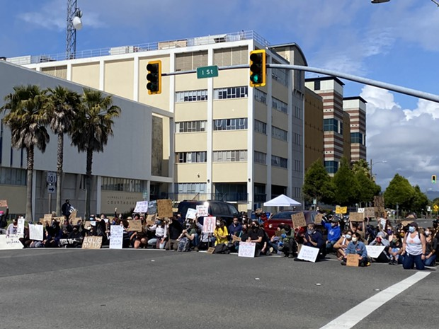 Scene at today's protest at Fifth and I Streets. - MARK MCKENNA
