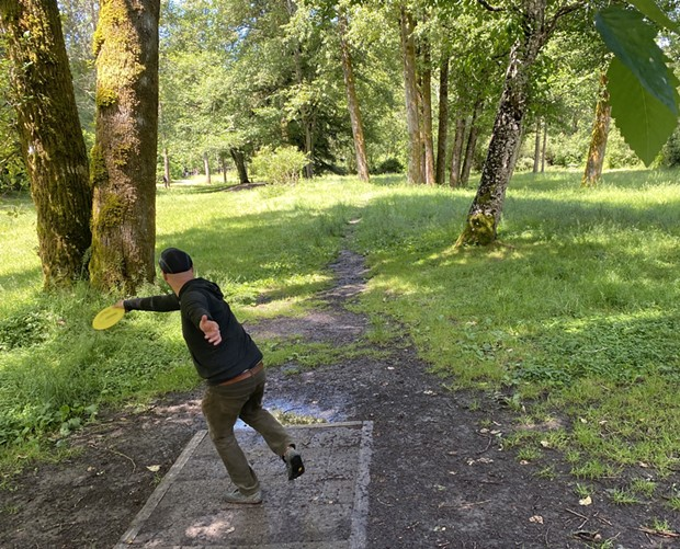 A man tees off on the newly reopened Mad River Pump Station 4 disc golf course. - ASHLEY HARRELL