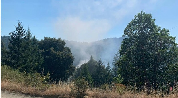 Smoke rising from a vegetation fire in the Benbow area. - CRAIG JOHNSON