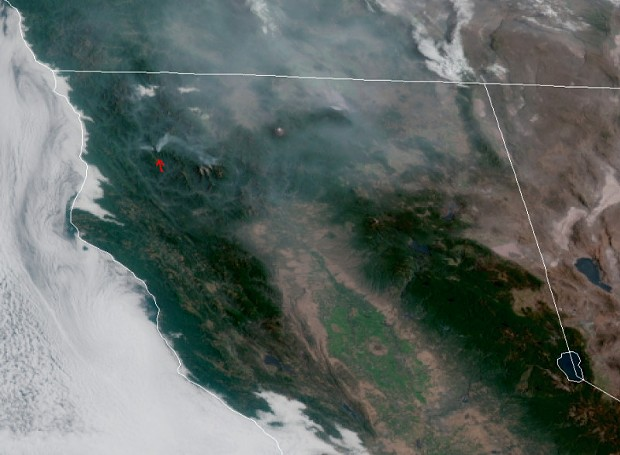 Smoke from the Red Fire and the Salmon Fire are indicated by a red arrow. - IMAGERY FROM THE GOES WEST SATELLITE ON JULY 28