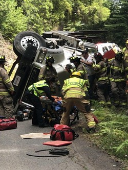 A logging truck flipped on Kneeland Rd. - SUBMITTED