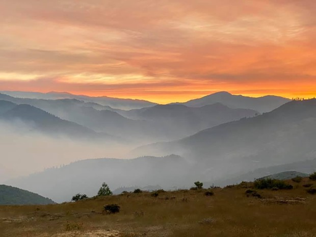 Smoky sunset, looking southwest toward Red and Salmon fires, - US FOREST SERVICE BY KARUNA GREENBERG, SALMON RIVER COMMUNITY LIAISON