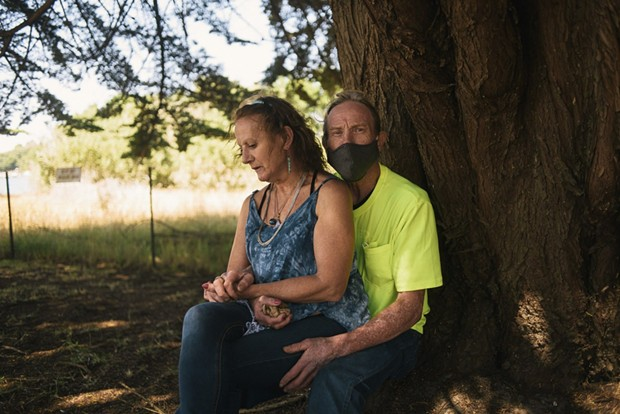 Portrait of Ernie Bull and Mary Wildman in Eureka, Calif. on August 7, 2020. Despite the coronavirus pandemic, Bull and Wildman were evicted from their home in July and have been homeless for over a month. - ALEXANDRA HOOTNICK FOR CALMATTERS