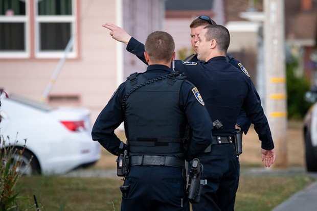 Eureka Police officers at the scene of a July 23 standoff with a reportedly suicidal man. - MARK MCKENNA