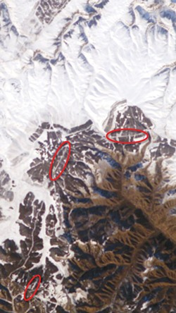 Enlargement of part of a digital photo of Inner Mongolia about 200 miles north of Beijing, taken with a 180 millimeter telephoto lens from the International Space Station in November of 2004. Thanks to fresh snow and bright sunlight, sections of the Great Wall of China can be seen (in red ovals). No astronaut has reported seeing the wall with the naked eye. - IMAGE VIA NASA