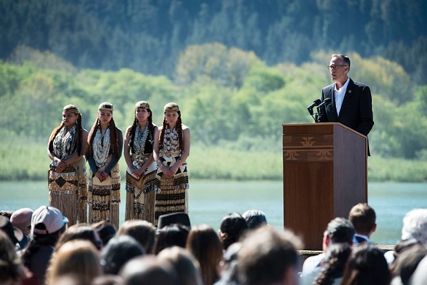 North Coast Congressman Jared Huffman, flanked by Yurok dancers, shortly before the signing of an agreement to remove four hydroelectric dams along the Klamath River in 2016. - MARK MCKENNA