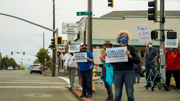 "Demonstrators in Eureka display signs at a ""Save the Post Office Saturday"" rally. - ZACH LATHOURIS"