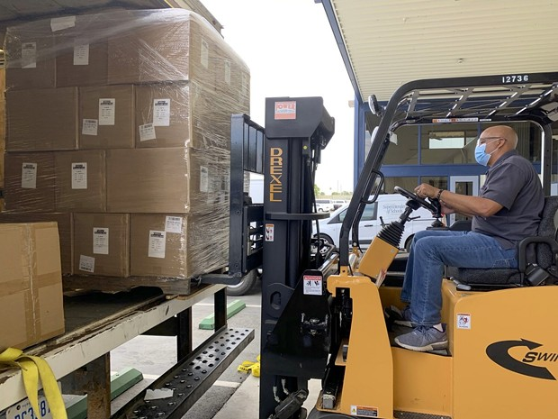A delivery of state-supplied masks, face shields, no-touch thermometers, and hand sanitizer arrive for when Kern County schools are able to open for in-person instruction. - KERN COUNTY OFFICE OF EDUCATION