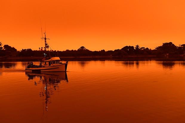 Wildfire smoke turned Humboldt County skies orange throughout the day Wednesday. - MARK MCKENNA