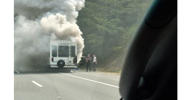 Smoke boiling from the vehicle. - [PHOTO FROM JASON DANIELS]