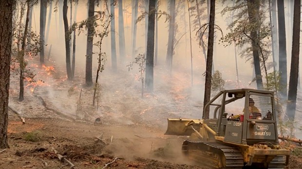 A dozer works to slow the spread of fire near Ruth on Sept 28. - MIKE MCMILLAN