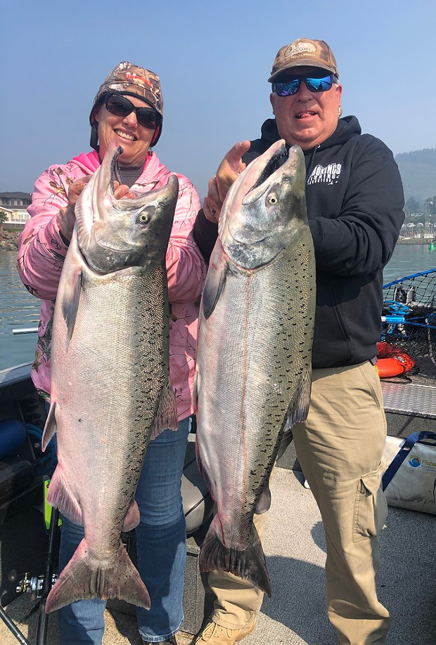 Mellisa and Ed Brusven of Fallon, Nevada, hold a pair of 30-plus-pound king salmon caught Oct. 1 at the mouth of the Chetco River while fishing with guide Andy Martin of Wild Rivers Fishing. - COURTESY OF WILD RIVERS FISHING