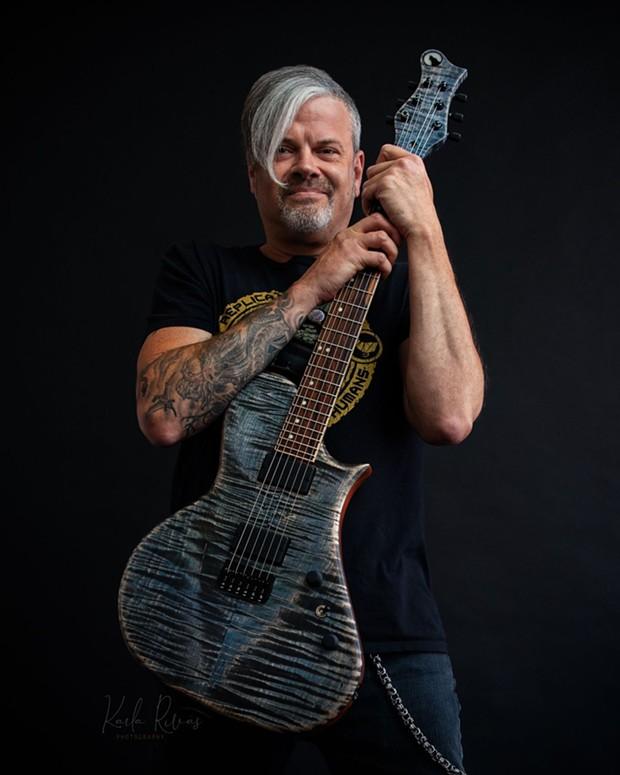 Navarro with one of his custom guitars. - COURTESY OF WOLF NAVARRO