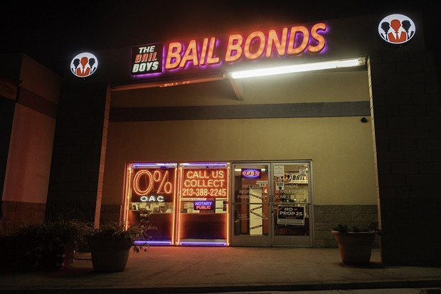 "The Bail Boys bail bonds displays a ""No on Prop 25"" poster in downtown Los Angeles on Oct. 21, 2020. Prop. 25 would end California's current cash bail system and replace it with a three tier risk assessment system. - PHOTO BY TASH KIMMELL FOR CALMATTERS."