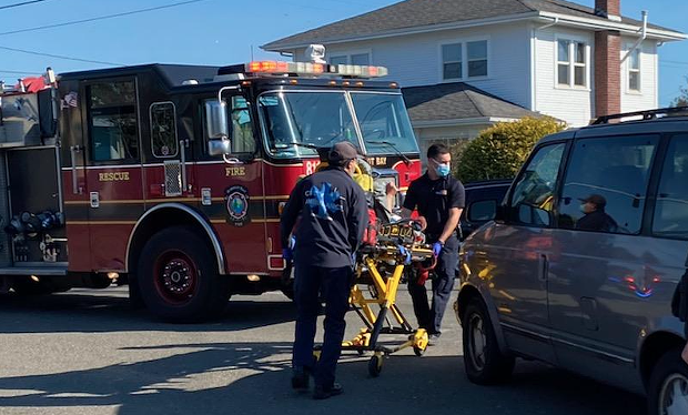 Emergency personnel uses a stretcher to take a victim to the ambulance. - MARK MCKENNA