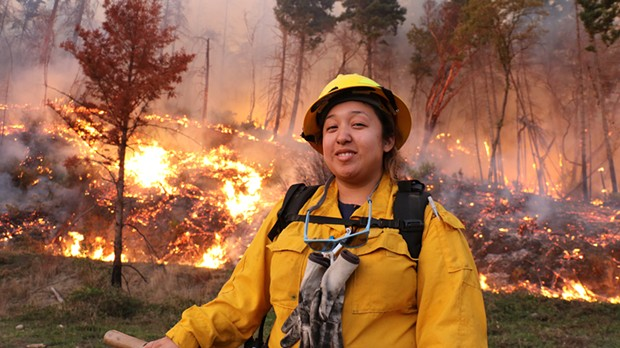 Vikki Preston, a member of the Karuk Tribe, pauses to catch her breath after her crew ignited accumulated woody fuels on a slope near Orleans in a controlled burn two years ago. - SUBMITTED