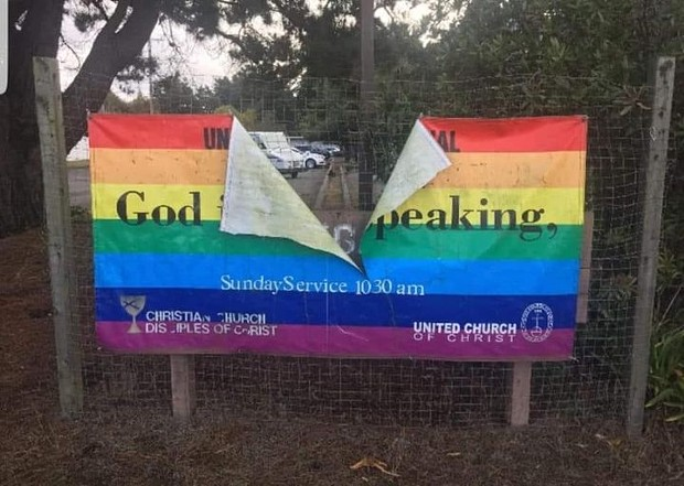 """The words """"God is still speaking"""" are obscured after the United Congregational Christian Church's rainbow flag was destroyed this week. - UNITED CONGREGATIONAL CHRISTIAN CHURCH"""