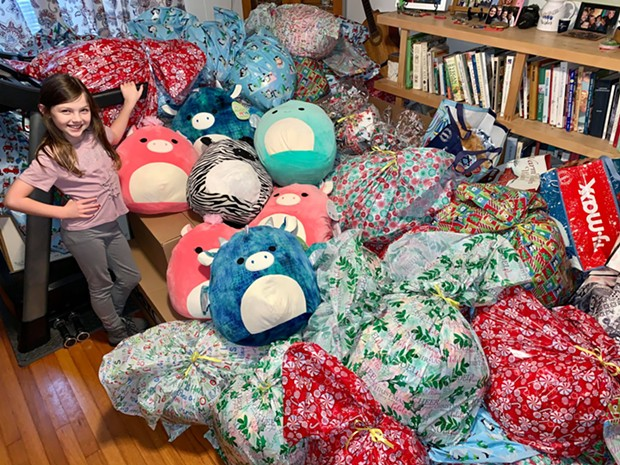 Clover Churchill with 100 bundles and some Squishmallows - SUBMITTED