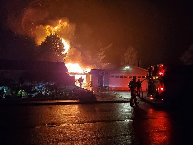 A shop was fully engulfed in flames on Holly Drive Friday night. - PHOTOS BY JOSH NIKOLAUSON