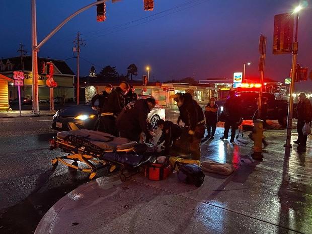 Emergency personnel work on the victim. - MARK MCKENNA