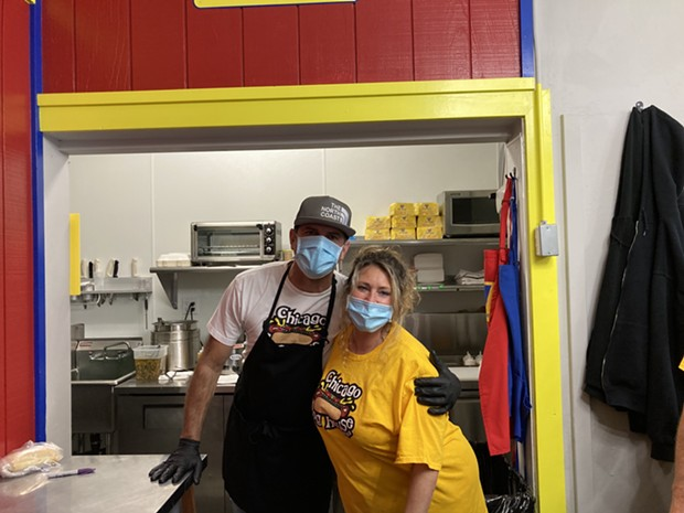 Todd and Carrie Nuse, owners of Chicago Dog House. - PHOTO BY JENNIFER FUMIKO CAHILL