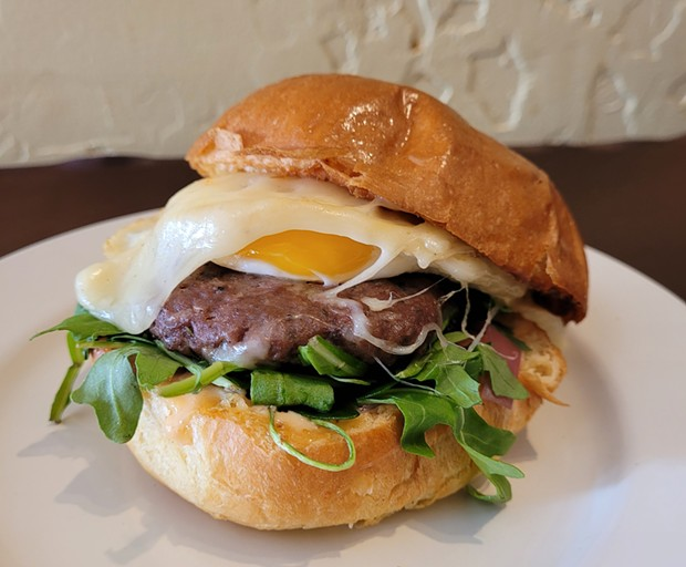 An OAB burger topped with a fried egg. - SUBMITTED
