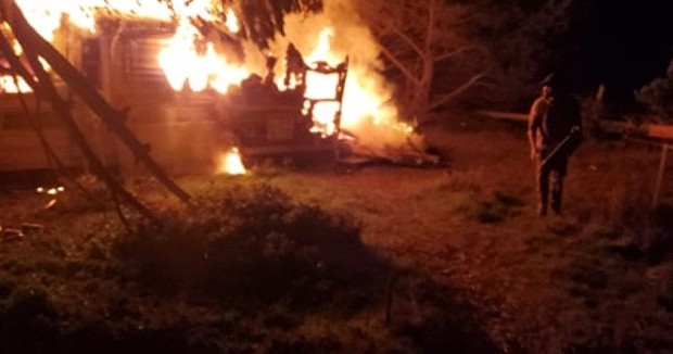 A fatal fire engulfs a travel trailer in Manila last night. - MIKE CARLSON