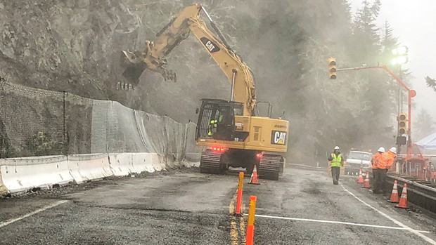 Clean-up work on the slide. - CALTRANS