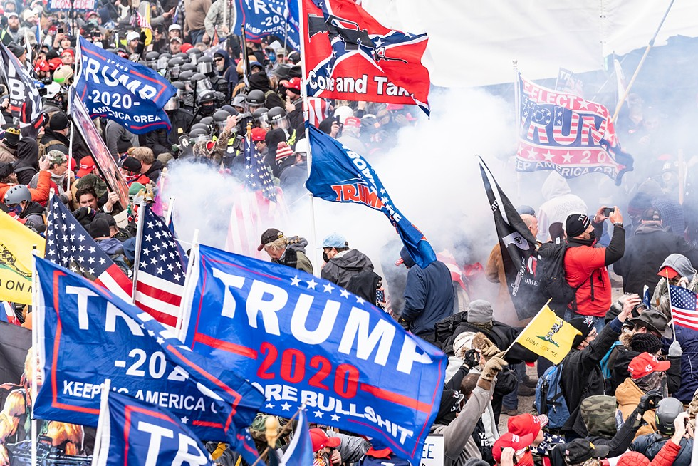 Smoke rises after police used pepper-ball guns against Pro-Trump protesters rallying around the U.S. Capitol before the siege. - LEV RADIN / SHUTTERSTOCK