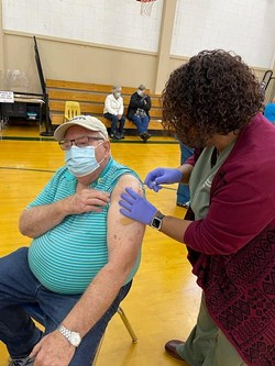 Dale Stocky celebrates his 75th birthday by getting the COVID-19 vaccination he'd newly become eligible for at a Mad River Community Hospital vaccine clinic Jan. 23 at Pacific Union Elementary School. - FILE
